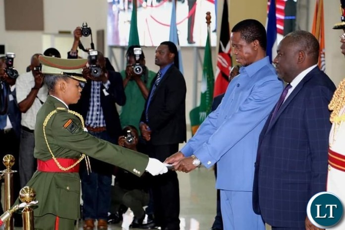 President Edgar Lungu presents the certificate to Major Charity Penyani during the Combined Graduation Ceremony of the 22nd Command Staff Course and 45th University of Zambia Defense and Security Studies on Thursday 28 November, 2019. Pictures by ROYD SIBAJENE/ZANIS