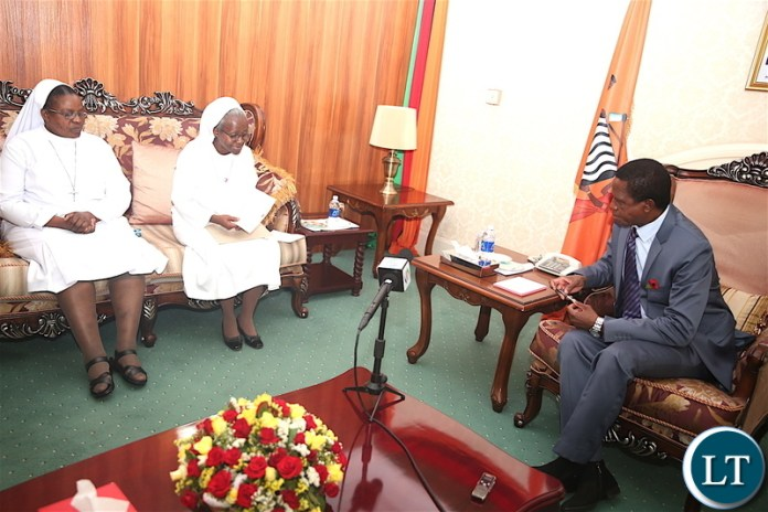 President Lungu greets Kabulonga's Cheshire Home Director Sr Fatima Chisalukila at State House where a delegation of Catholic Sisters from Cheshire home paid a Courtesy call on him on Friday, November 8,2019 -Pictures by THOMAS NSAMA