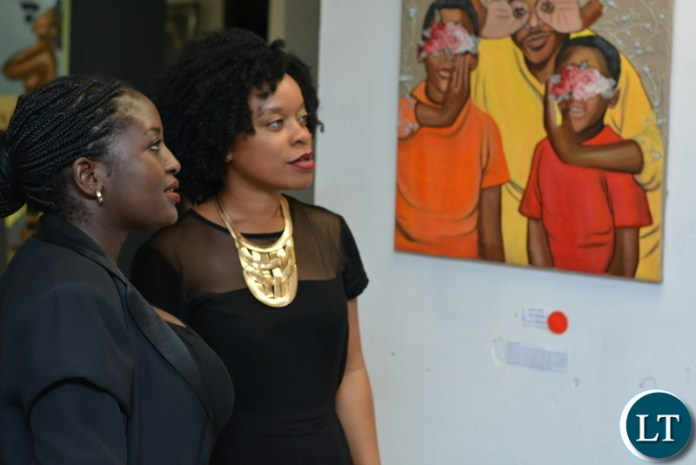 """Guests at a solo art exhibition themed """"The Gate Keepers of Morality"""", at the ALN Building in Longacres"""