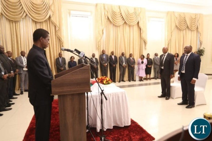 President Lungu during the swearing in ceremony of Deputy Auditor General in the office of the Auditor General, Francis Mbewe and Public Policy Specialist –Policy Analysis and Co-ordination Division at State House
