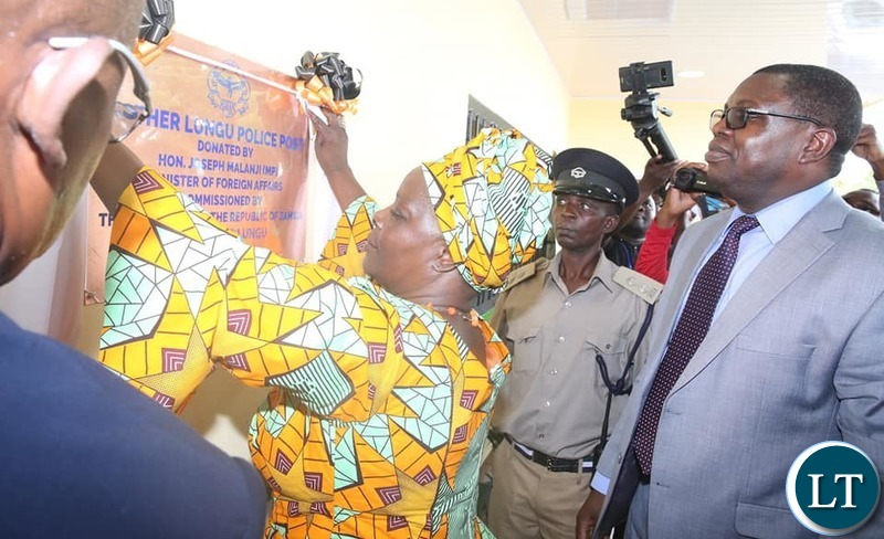 First Lady Esther Lungu with Kitwe's Nkana East, the area member of Parliament for Kwacha Constituency Hon Joseph Malanji at the handover of a newly build Police Station