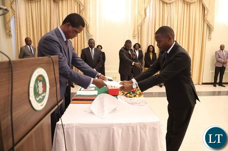 President Edgar Chagwa Lungu congratulates newly appointed Special Assistant to the President for Political affairs Chris Zimba during the Swearing in Ceremony at State House on Friday, December 20,2019 Pictures by EDDIE MWANALEZA