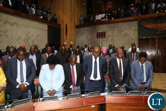 PF Cabinent Ministers in prayer mode during the Presiden't address in parliament
