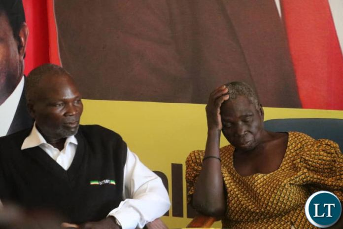 Samuel Kasoleka with his sister Mirriam at the UPND secretariat during the news briefing