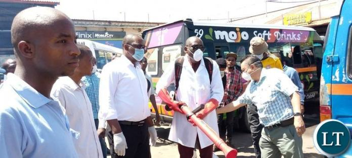 Minister of Local Government Charles Banda leading a team who conducted a sanitising exercise for flash mini buses and the entire millennium bus station