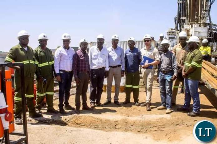 Dr Banda standing next to Energy Minister Mathew Nkuwa fifth and sixth from left