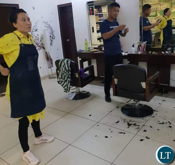 The Workers at the Chinese owned Angels Barbershop at Arcades Shopping Mall