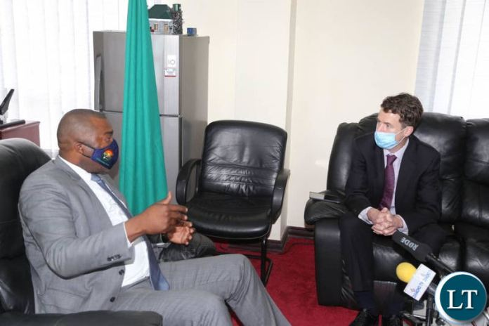 Lusambo with UK High Commissioner to Zambia Nicholas Woolley