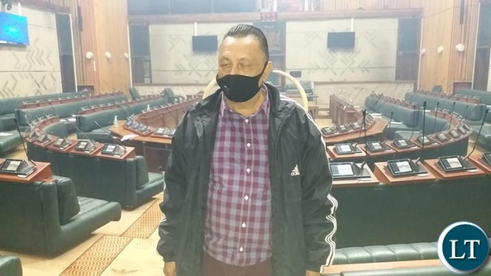 The Association of Indian Community in Zambia Member Mr Ismail Khankara standing in the parliament Chamber during the disinfection Exercise
