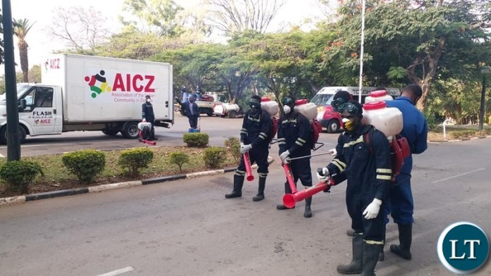 Association of Indian Community in Zambia (AICZ) disinfecting Parliament building following an increase in positive Covid-19