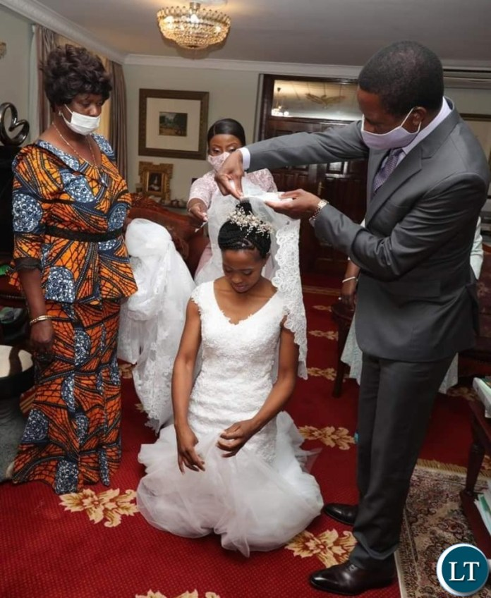 Edgar  Lungu and Mrs Esther Lungu prepare to give out their daughter's hand in marriage to  Patrick Mwansa at this afternoon' Weeding Ceremony