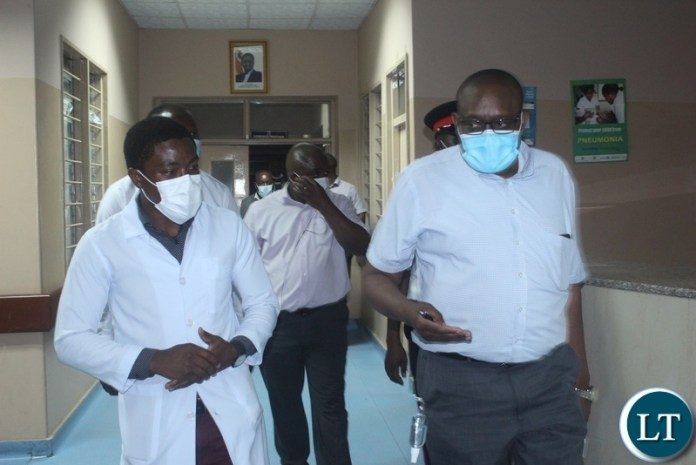 Ministry of Health Technical Services Permanent Secretary Dr. Kennedy Malama (r) shows gratitude to Mongu District Hospital Medical Officer In-Charge Dr. Chilufya Musonda (l) during the tour of health facilities in Mongu