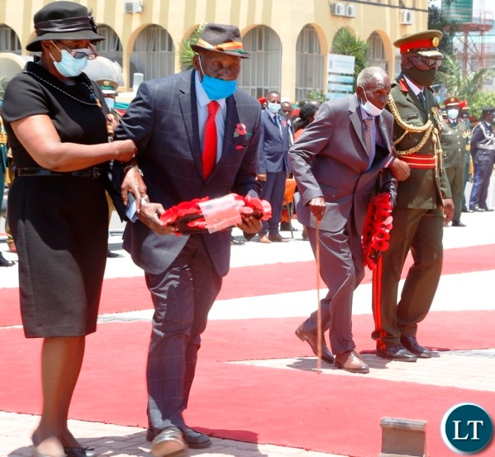 Freedom fighters Jackson Bwalya, aged 103 (right) and John Monze, aged 98 being led to go and lay wreaths at the National Cenotaph during the remembrance day.Picture by SUNDAY BWALYA/ZANIS