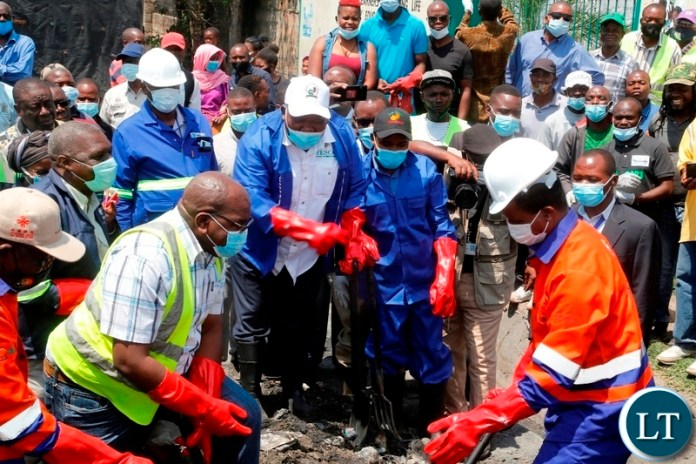 President Edgar Lungu at the drainage clean up exercise in Mandevu Lusaka.