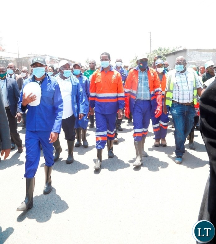 President Edgar Lungu  and Ministers tour mandevu markert during the drainage clean up exercise in Lusaka.