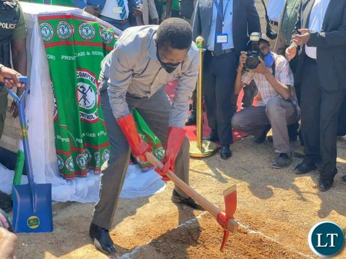 President Edgar Lungu putting a foundation stone on the construction site for an international convention centre, 3 star hotel and shopping mall