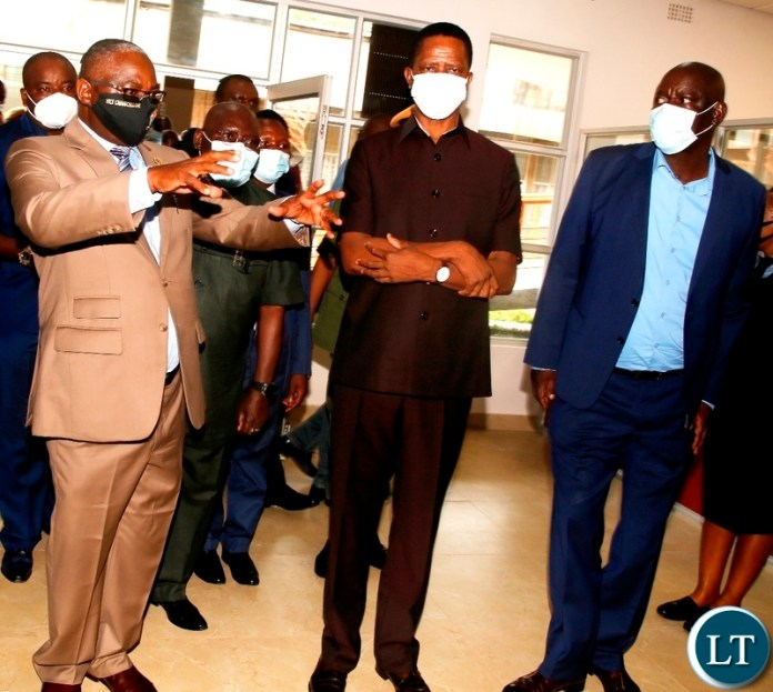 President Edgar Lungu cuts the Ribbon to officially commission the new teaching and learning complex lecture theatre building at UNZA today. Looking on (right) is UNZA Vice Chancellor Prof Luke Mumba. Picture by SUNDAY BWALYA/ZANIS