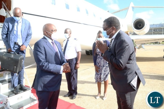 Minister of Foreign Affairs Joseph Malanji welcomes President of Botswana Dr. Mokgweesti Eric Masisi on his arrival at Kenneth Kunda International airport yesterday, Wednesday, March 31, 2021. Picture by ROYD SIBAJENE/ZANIS
