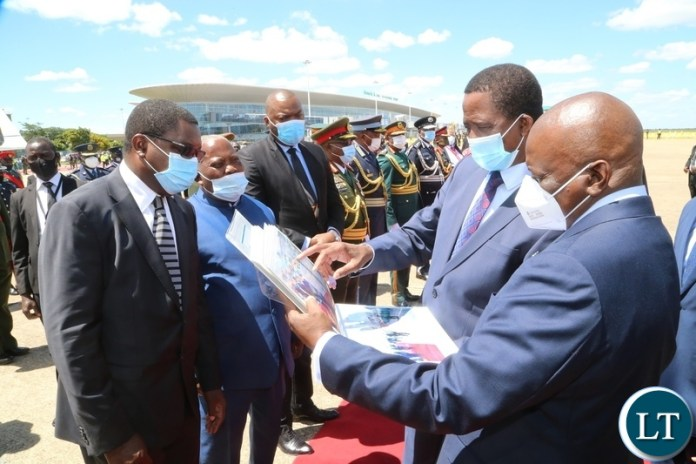 President Edgar Lungu with his Botswana counterpart  Dr. Mokgweesti Eric Masisi admiring the presidential photo album of his visit at Kenneth Kaunda International airport before departure to Botswana yesterday, Wednesday, March 31, 2021. Picture by ROYD SIBAJENE/ZANIS