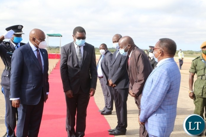Minister of Foreign Affairs Joseph Malanji introduces President of Botswana Dr. Mokgweesti Eric Masisi to Zambian officials at Kenneth Kunda International airport yesterday, Wednesday, March 31, 2021. Picture by ROYD SIBAJENE/ZANIS