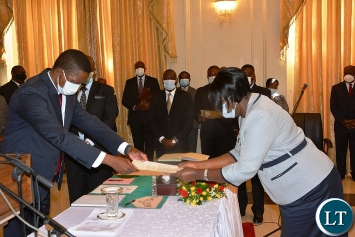 Justice Flugency Chisanga handing in her affidavit of oath to President Lungu when she was sworn in as Supreme Court Judge at State House