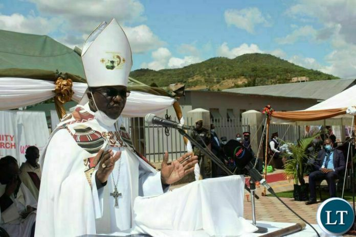 ARCHBISHOP of Central Africa, Albert Chama, speaking during the commissioning of the John Osmas Anglican church building in Chipata yesterday. PICTURE BY STEPHEN MUKOBEKO/ZANIS