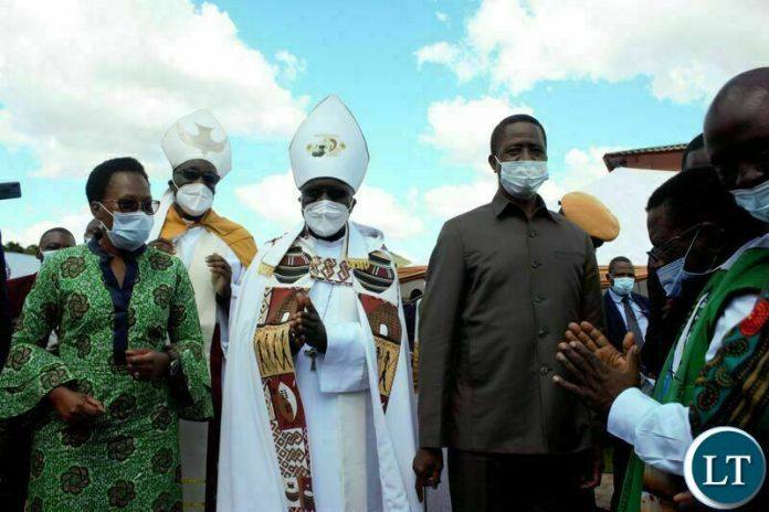 PRESIDENT Edgar Lungu, Anglican Archbishop of Central Africa, Albert Chama ( Middle) and Eastern Province Permanent Secretary, Veronica Mwiche, during the commissioning of the John Osmas Anglican Church building in Chipata yesterday. PICTURE BY STEPHEN MUKOBEKO/ZANIS