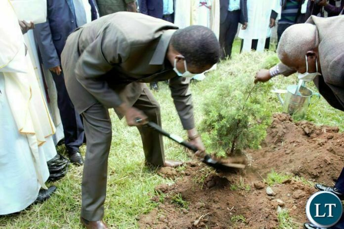 PRESIDENT Edgar Lungu, plants a tree at Saint Pauls Anglican Church in Chipata after he commissioned the new John Osmas Anglican Church building in Chipata yesterday. PICTURE BY STEPHEN MUKOBEKO/ZANIS