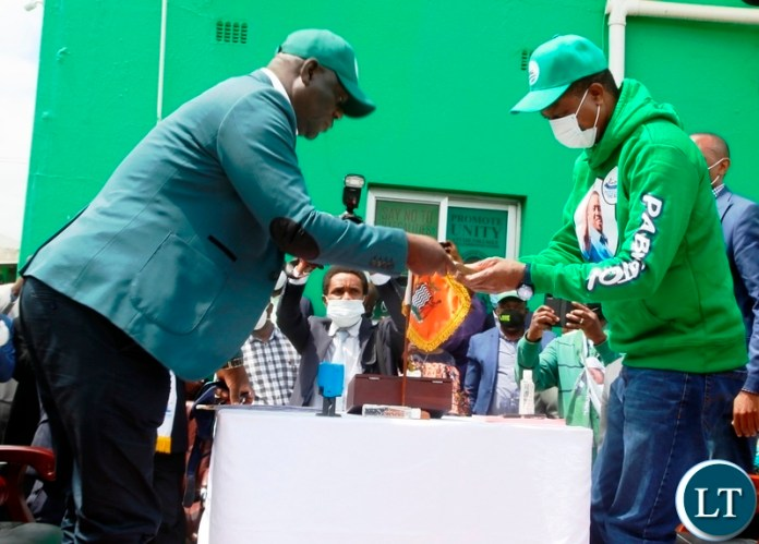 President Edgar Lungu hands in nomination fee to PF Party Secretary General Davies Mwila during the filling in of nominations at the PF Secretariat. Picture by SUNDAY BWALYA/ZANIS