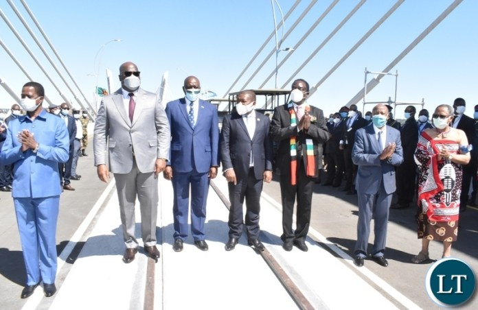 Heads of state pose for a grop picture shortly after official opening of Kazungula Bridge
