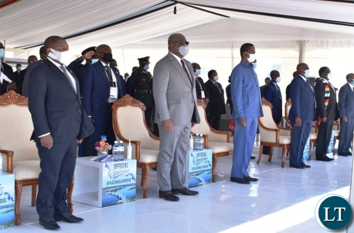 Presidents listening to nation anthems being played during the official opening of Kazungula border post