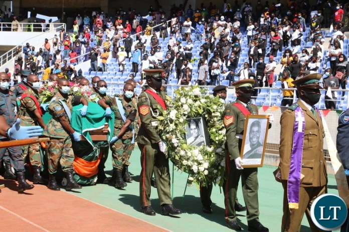Men in uniform  carrying the remains of the late first Zambian President Dr Kenneth Kaunda at Levy Mwanawasa Stadium during the church service in Ndola yesterday. Monday, June 28, 2021. Picture by ROYD SIBAJENE ZANIS
