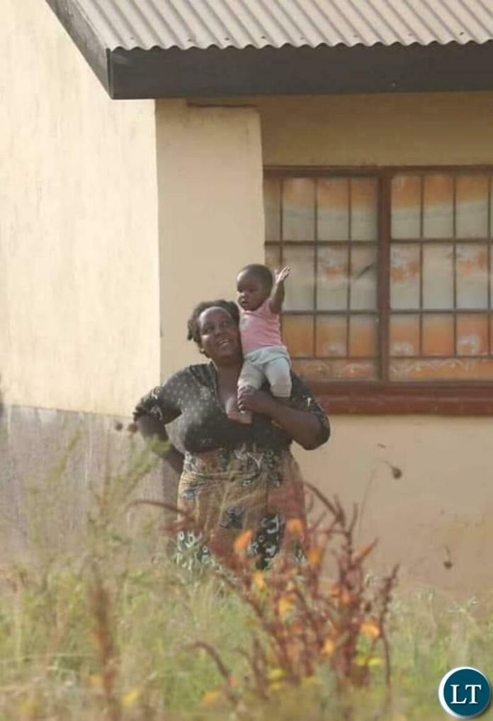 Image of child made to wave the UPND symbol
