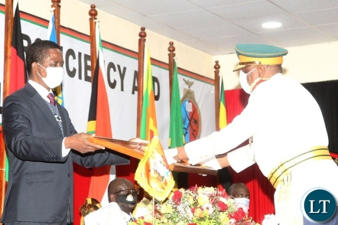 President Edgar Lungu gives a recognition award to Zambia National Service Commandant ,Lt. General,Nathhan Mulenga during the silver jubilee celebration and official launch of the new staff college and National Defence University in Lusaka.