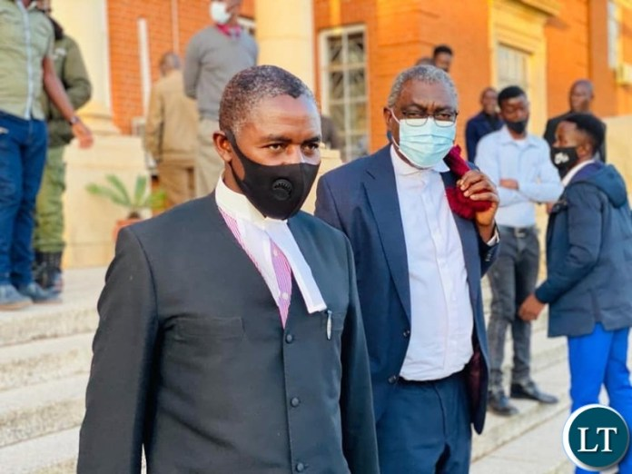 State Counsel Sakwiba Sikota (R) after the court Session
