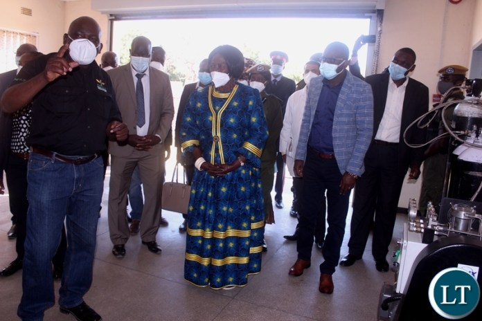 Lewanika General Hospital Principal Medical Equipment Officer Elias Luhana (l) explains to Vice President Inonge Wina (c) on how oxygen flows from the plant to the patients in the wards during the inspection of the oxygen plant at Lewanika General Hospital in Mongu Western Province