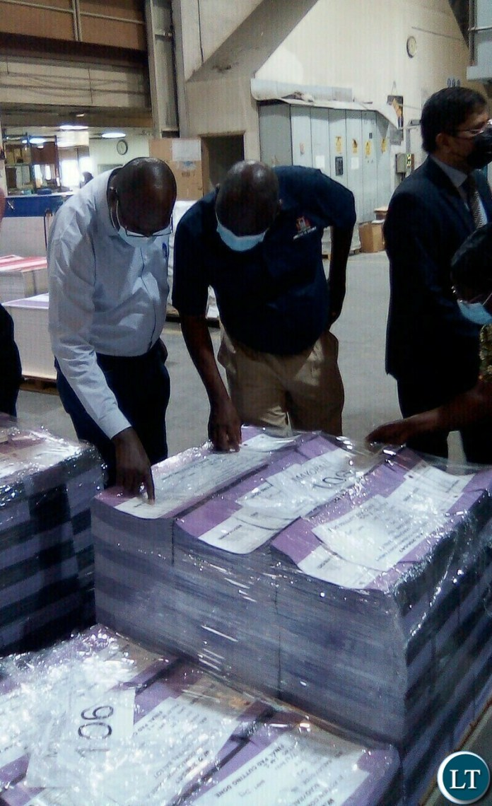 PF Vice National Chairperson Davis Chama(left) and ECZ Commissioner Ret.Major.Gen Vincent Mukanda check on printed ballot papers