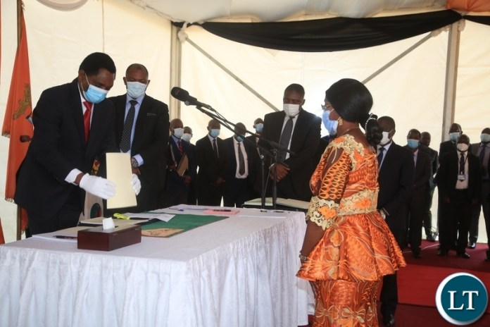 PRESIDENT Hakainde Hichilema with Minister of Health, Sylvia Masebo at swearing -in ceremony in Lusaka.