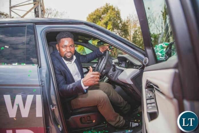Kelvin Bandela, winner of the Win a Range Rover promotion gets a feel of his new car