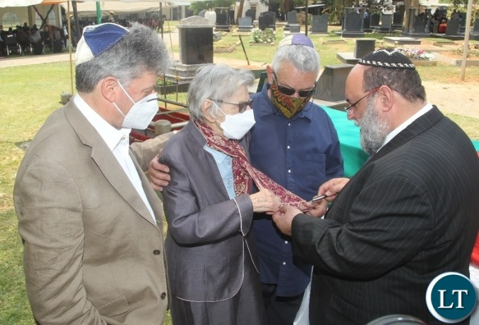THE Widow, Sara Zukas being consoles by Rabbis Silberhaft(r) and the son David Zukas(L) and Jewish members at the burial and Funeral Service of Late former Cabinet Minister Hon. Simon Ber Zukas in Lusaka.
