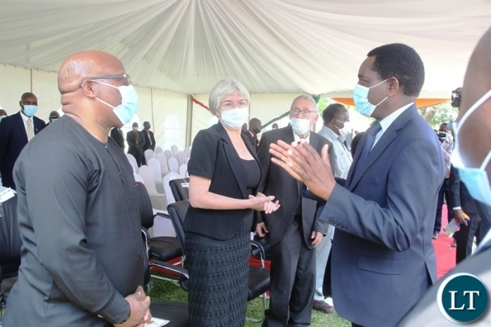 PRESIDENT Hakainde Hichilema confers with former Vice-President Nevers Mumba during the burial and Funeral Service of Late former Cabinet Minister Hon. Simon Ber Zukas in Lusaka