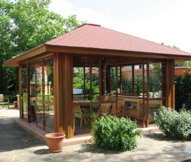 Wooden Gazebo Design With Sliding Glass Doors And Wooden Dining Furniture
