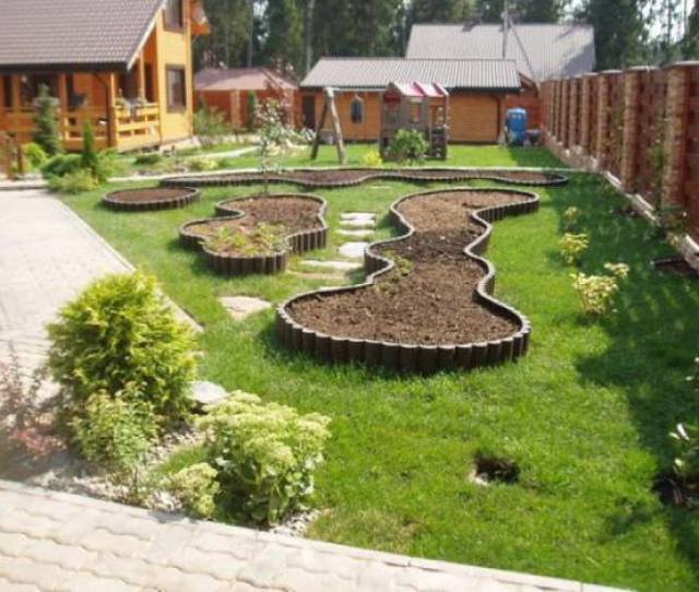 Garden Design And Grass Lawn With Raised Bed Borders