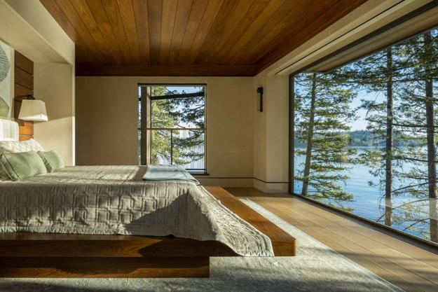 Lakefront Cliff House Design with Rocks Integrated into Interior Design and Spectacular Windows