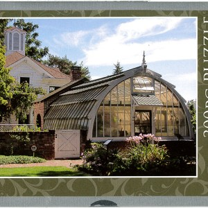 cover of the tin containing a puzzle featuring the Greenhouse at Luther Burbank Home & Gardens