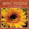 cover of the tin containing a puzzle featuring a sunflower