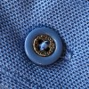detail of polo shirt button