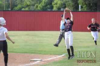 Hannah Trenary at first catching a fly ball.