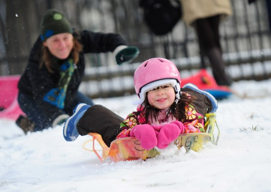 Children play in the snow near the U.S. Capitol Building in Washington