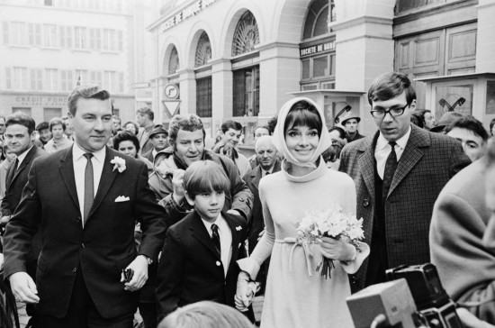 18 Jan 1969, Morges, Switzerland --- Original caption: Helped by Swiss policemen, actress Audrey Hepburn and her husband, Italian psychiatrist Dr. Andrea Dotti, make their way through a crowd of newsmen and onlookers January 18th following their wedding at the town hall of this Lake Geneva town. It was the second marriage for Miss Hepburn, 39, and the first for Dotti, 30. The actress had been previously married to actor Mel Ferrer, whom she both wed and divorced here. --- Image by © Bettmann/CORBIS